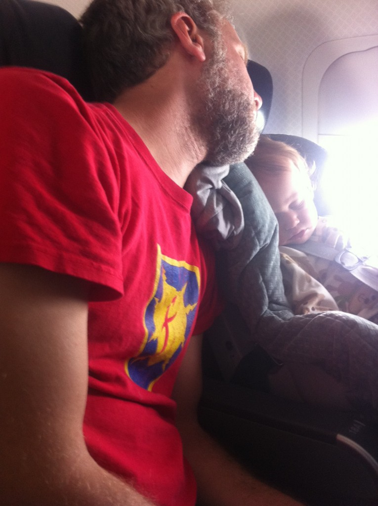 Sleeping on the plane with Daddy =)  She was SO good on the plane!