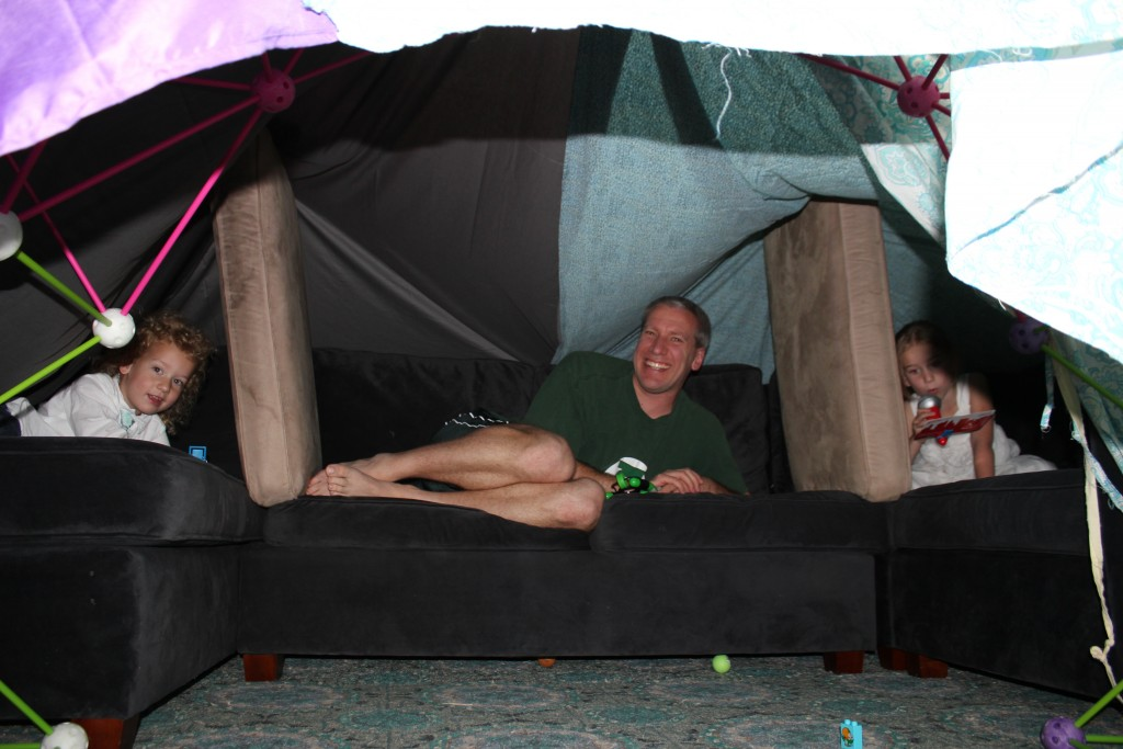 Eric built an epic blanket fort.  With three apartments inside.