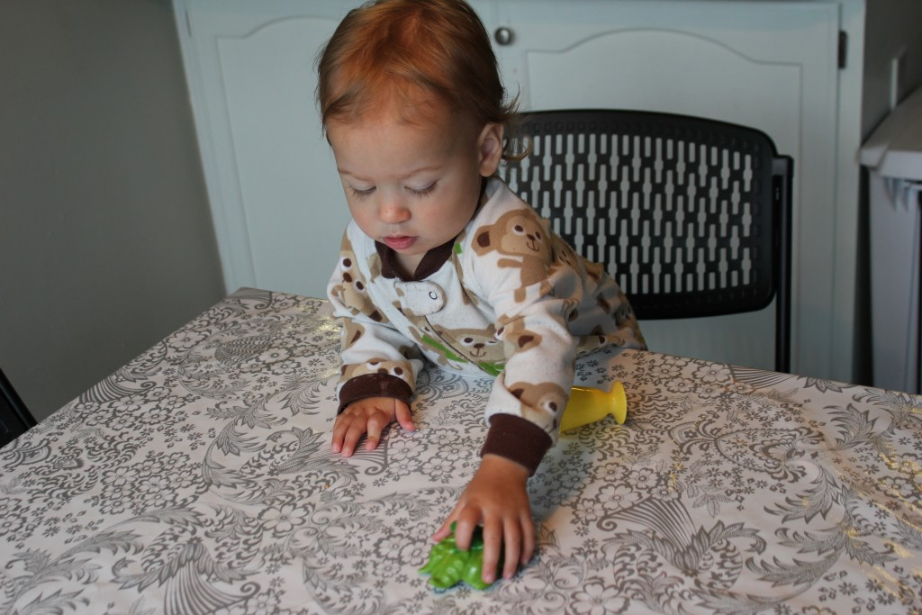 """Baby girl loves to climb!  Into chairs, on the table.  One morning I found her sitting on the table with her ankles crossed like a little lady and a big grin on her face. """"Look what I can do!"""""""