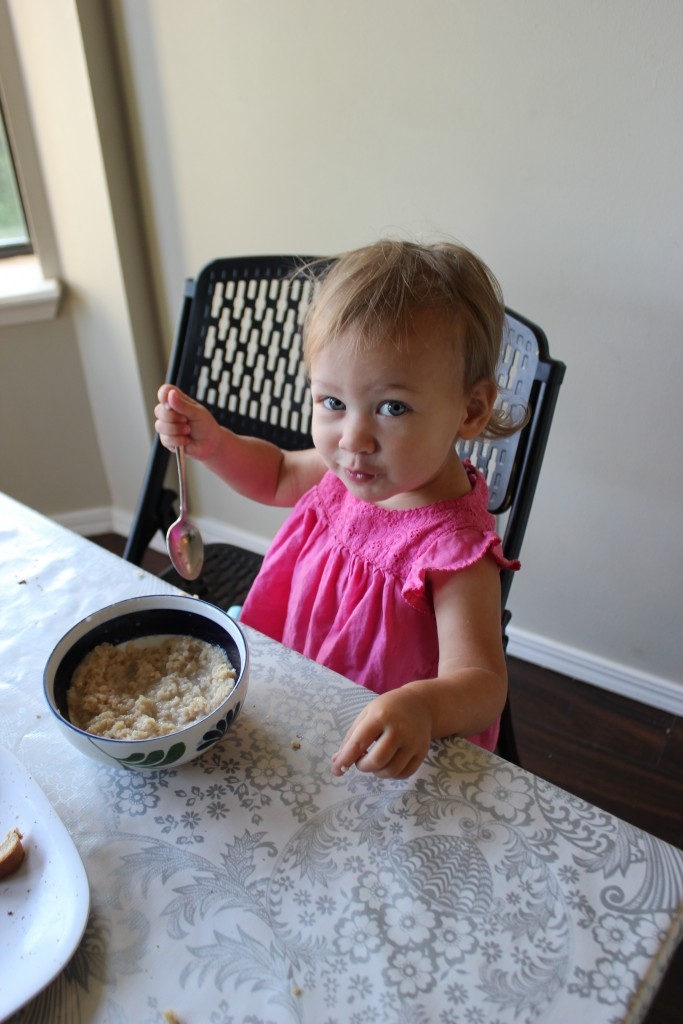 This is NOT her bowl.  Hence the mischief in her eyes =)  She does attempt to use spoons these days though.  And she loves oatmeal.