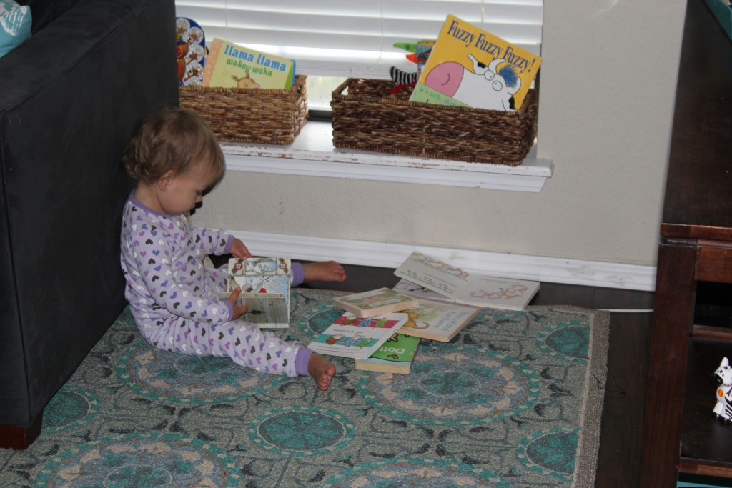 reading The Mitten, another winter book =)  Oh, she loves Bear Stays Up too.