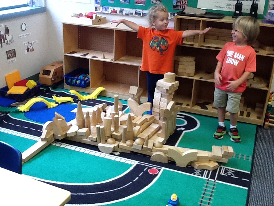 He loved getting to build with the wooden blocks =)