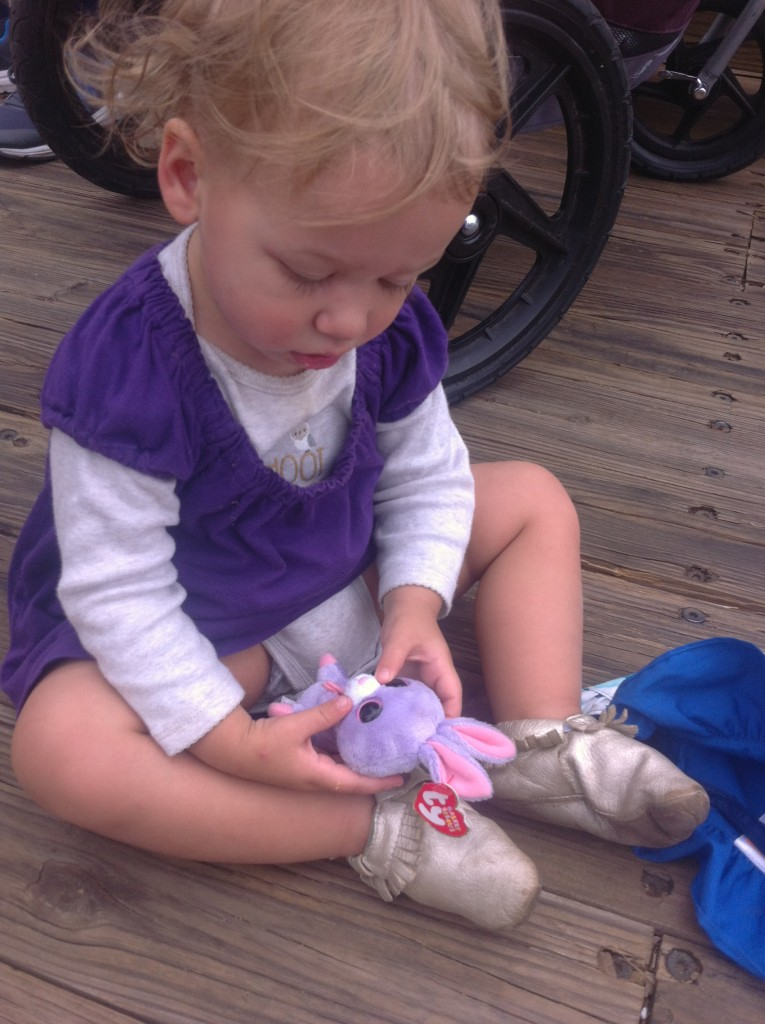 """She loves bunnies.  She knows they say """"hop hop!""""  Abbey gave her a bunny to be her friend at Everett's awesome zoo party.  We loved the photo scavenger hunt!"""