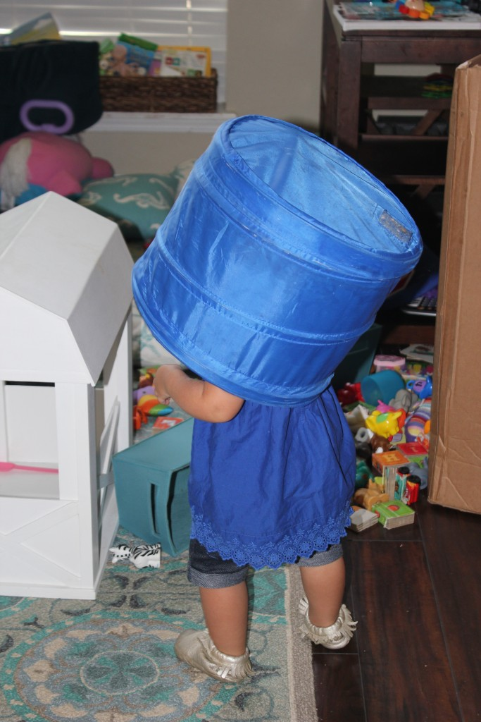 This bucket used to hold Magformers... that offended Maia, both because she loves to play magformers, and because she feels the bucket is better on her head.