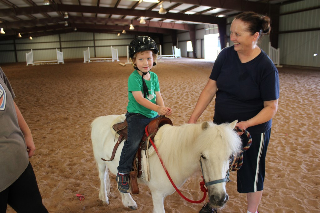 DZ got to go to Little Boots camp and ride an actual miniature horse!  And he painted him too =)