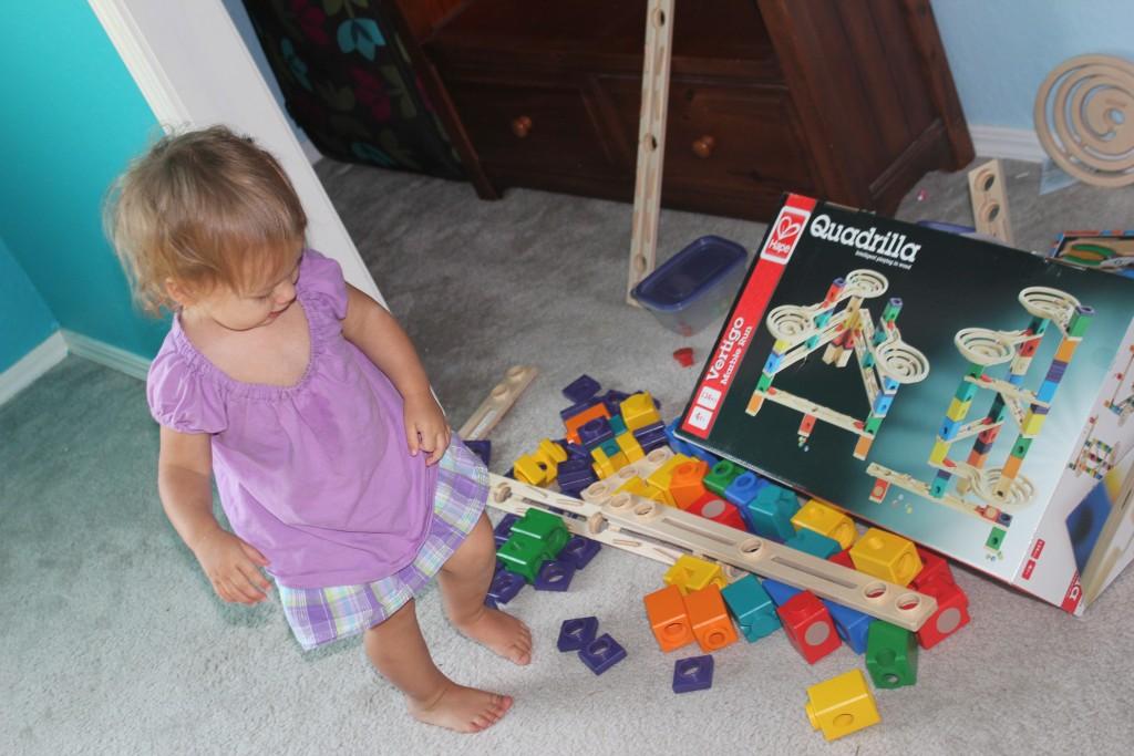 "While I was packing up the ocean room, as I took a trip downstairs with some boxes, Maia decided to ""help"" with the packing by dumping out the marble run.  She actually played really well with it!"