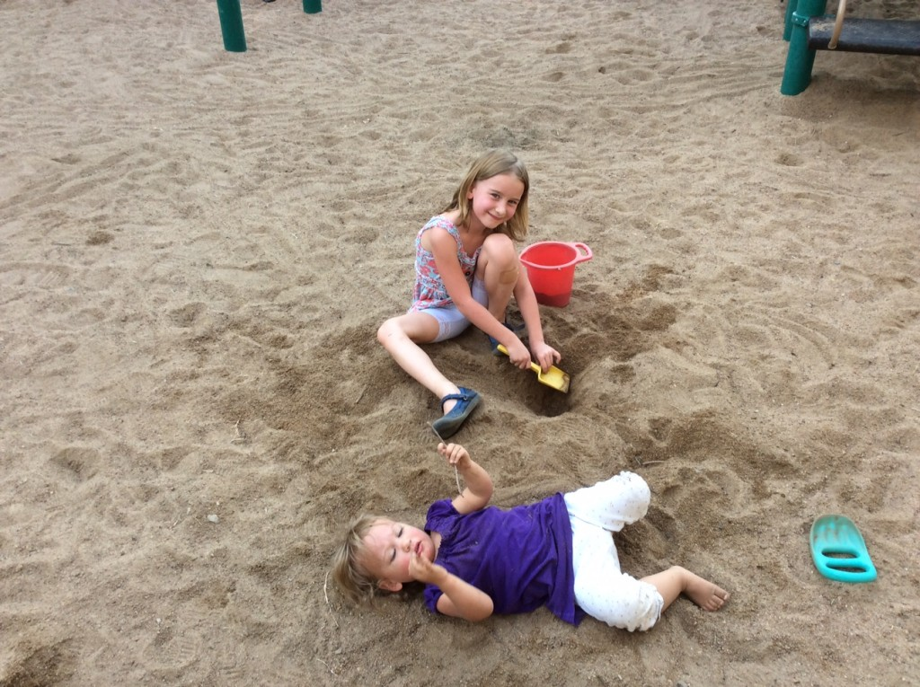 She had such a ball at the back to school picnic!  Dr. Hollingsworth got this picture of her enjoying the sand. =)  She will soon be bringing it home just like my other two kids!