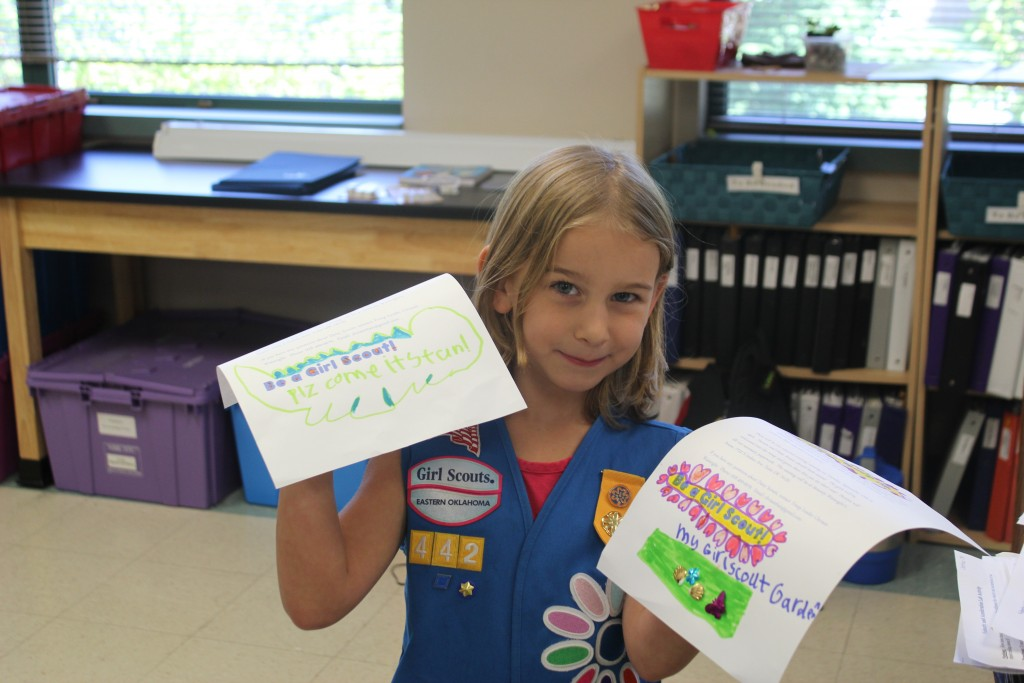 Making flyers to invite other girls in her class to join our Daisy Troop