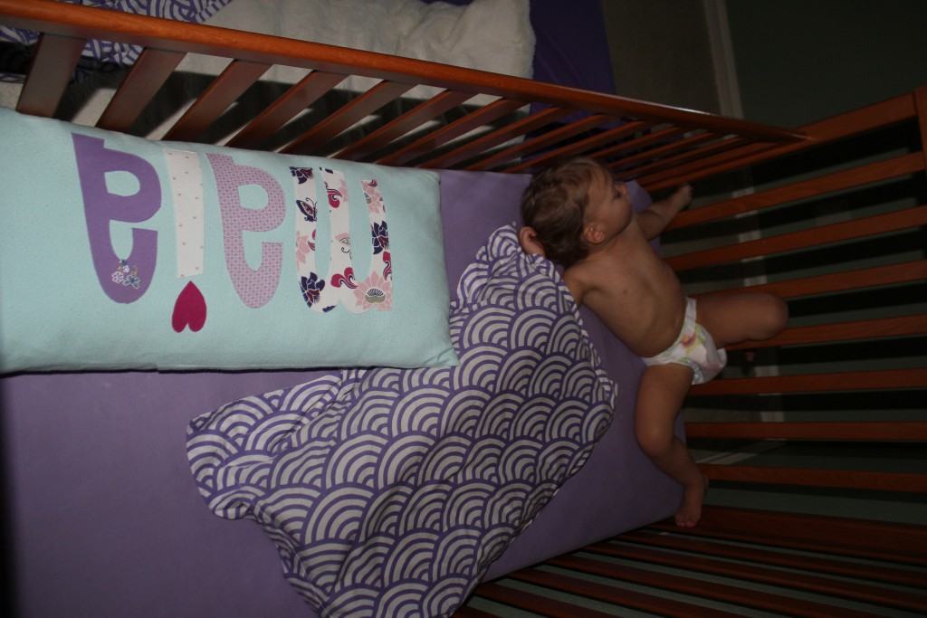 She sleeps in a different position every night, and grabs totally random stuff to put in her bed.  Tonight it was Daddy's pillow and her Maia pillow.  =)