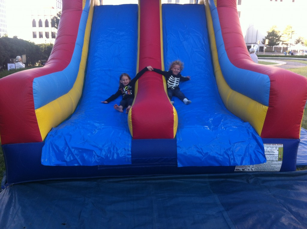Going down the slide together =) I love them!
