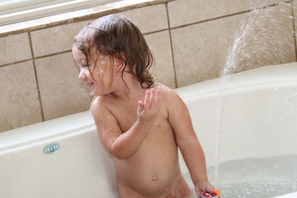 "Maia said ""Wa ha ha ha!"" More phrases added to her vocabulary during this bath: ""Stop that"" and ""Yet go!""  (let go)"