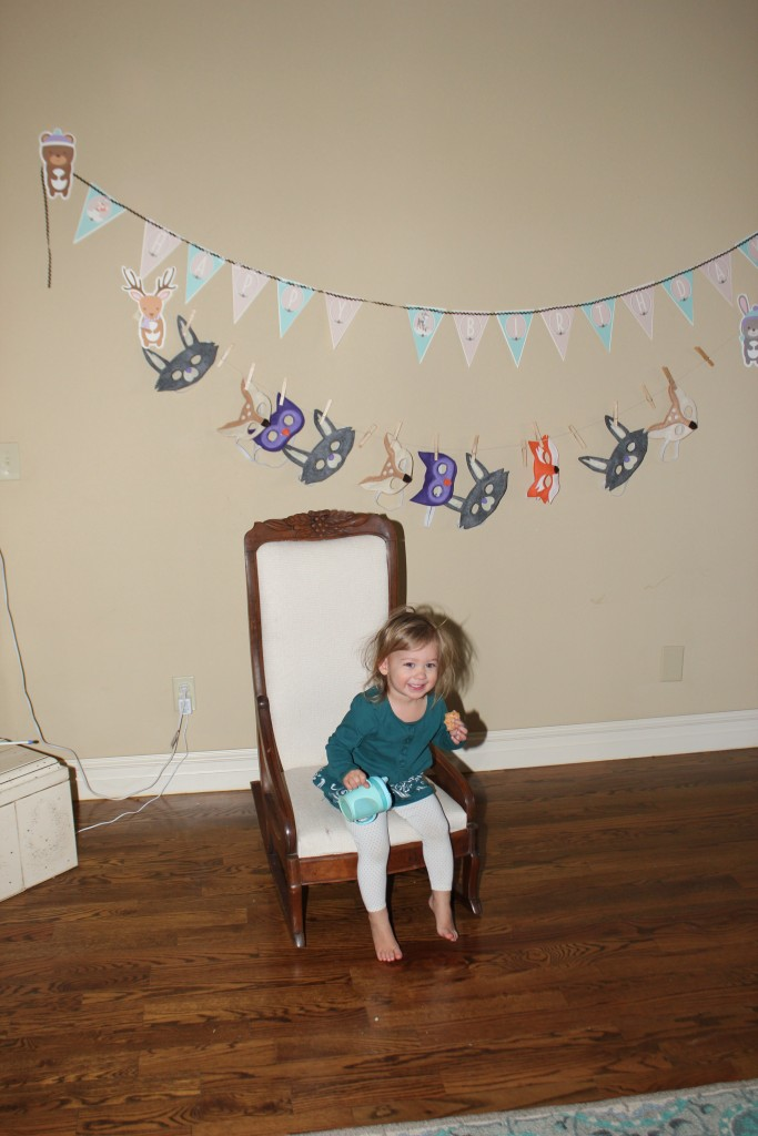 Maia, in her rocking chair, briefly =)  I didn't try to get her to wear a mask, but the kids still use the ones I made for DZ's second birthday so hopefully she will someday =)