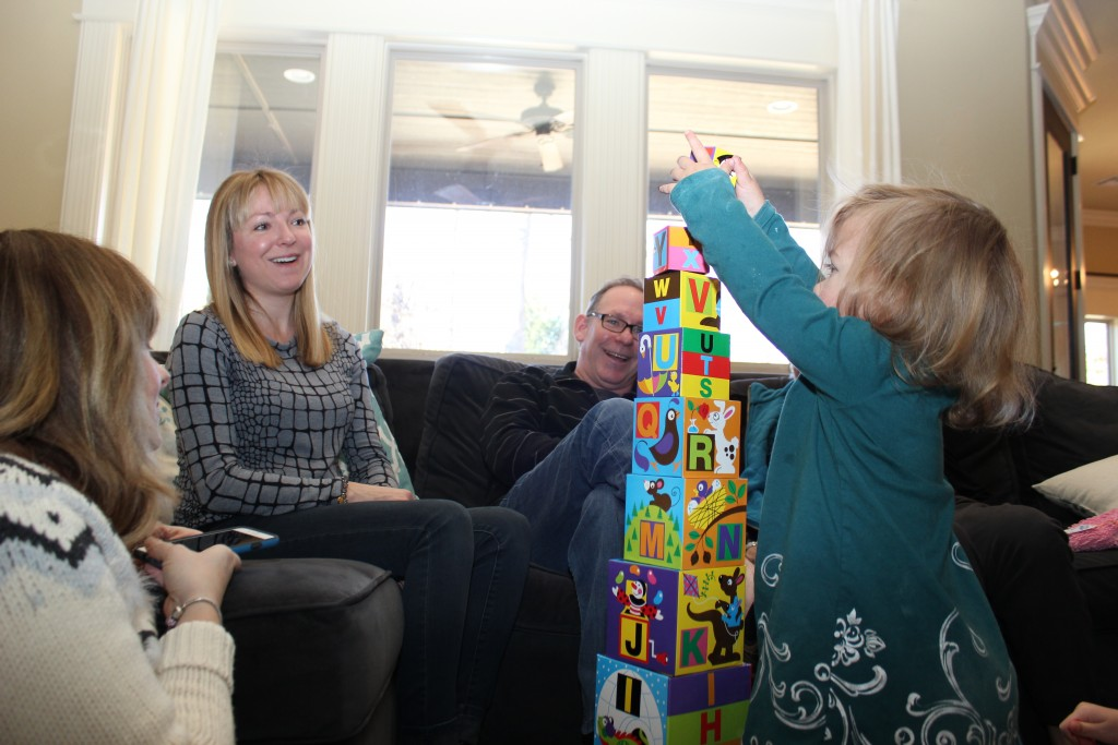 Maia liked unwrapping presents!  She opened this one, and said ABC!  But then moved on.  She was so focused on the awesome abc puzzle Gavin and Jennie got her, that she didn't notice the tower.  She finally turned her head at something Mike and Kelly said and did a classic double-take!  She loves this abc tower!  Happy girl =)
