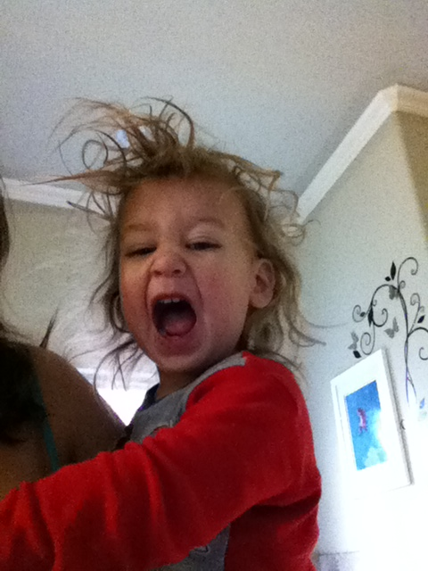 Amazing bedhead.  This is the face she made when she saw herself in the camera.  Love it!
