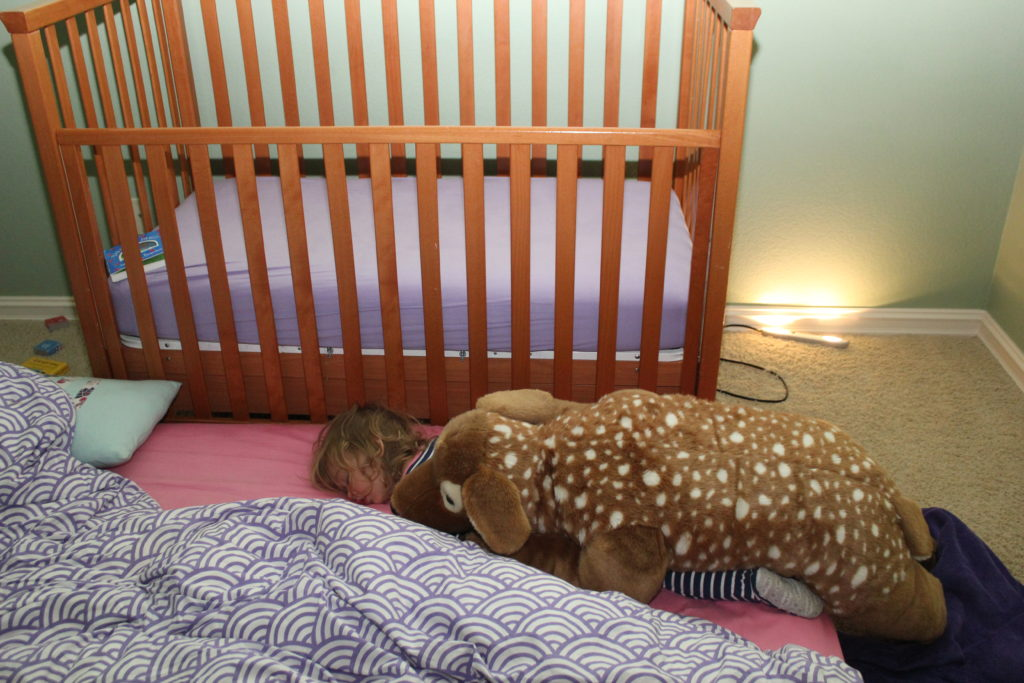 She fell asleep under her deer pillow. So adorable!