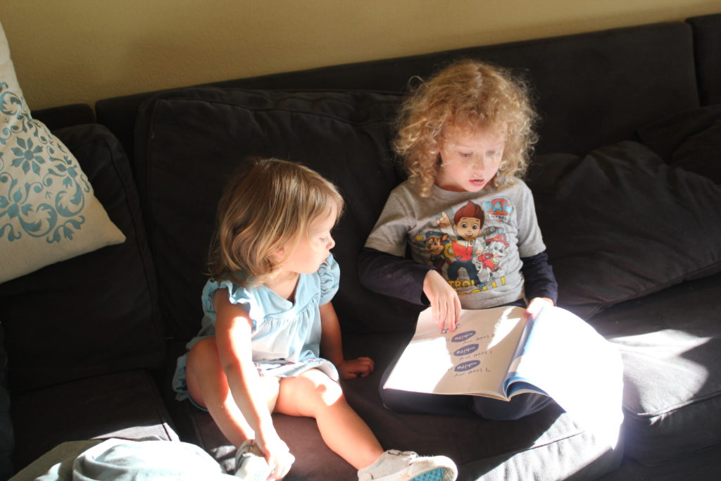 Reading Pete the Cat to Maia.  I love this SO much!!!!