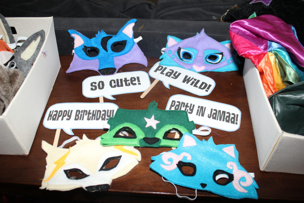The felt masks I made =) Originally I was going to make a bunch of animals in different colors, but then I texted to see if the girls could tell me what animal/color combinations they actually liked, so I made one for each person. =)